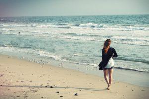 woman walk on beach